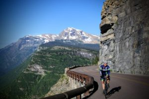 Cycler and mountain views, Cycling House bike trip, Glacier National Park, Mont.