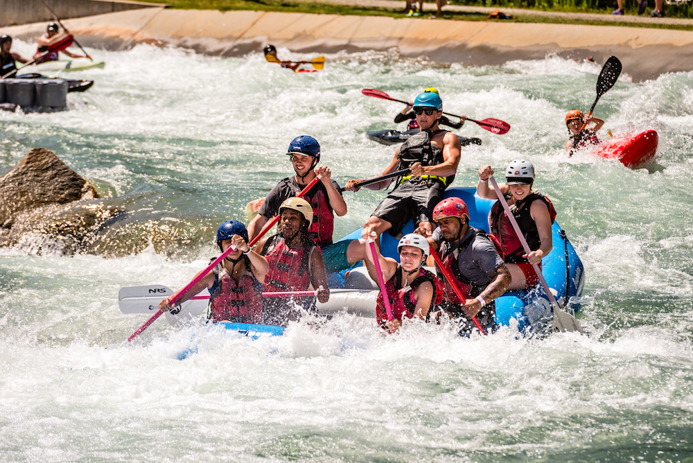 Group of people whitewater rafting at U.S. National Whitewater Center in Charlotte, North Carolina