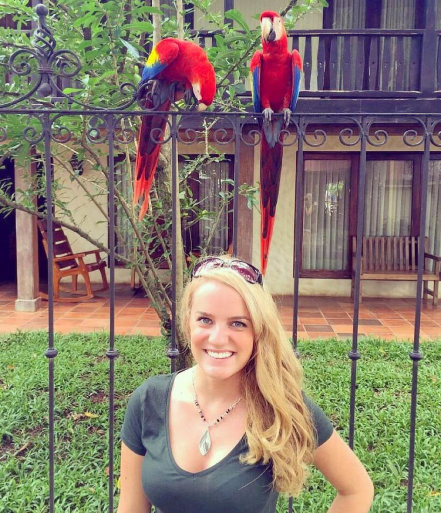 Associate Editor Cortney Erndt and macaws, Costa Rica