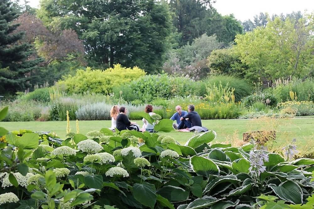 Group sitting on ground in Berkshire Botanical Garden