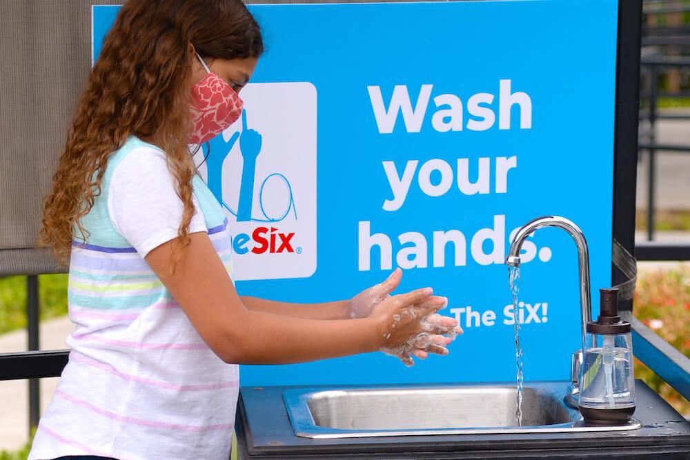 Six Flags Hurricane Harbor hand washing