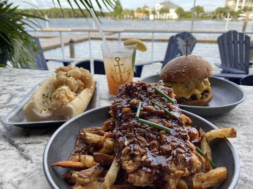 Anchor at Tchefuncte's. Double Stack burger, fried shrimp poboy with Grilled Steamed Bun and Brown butter, Louisiana Fish & Chips.